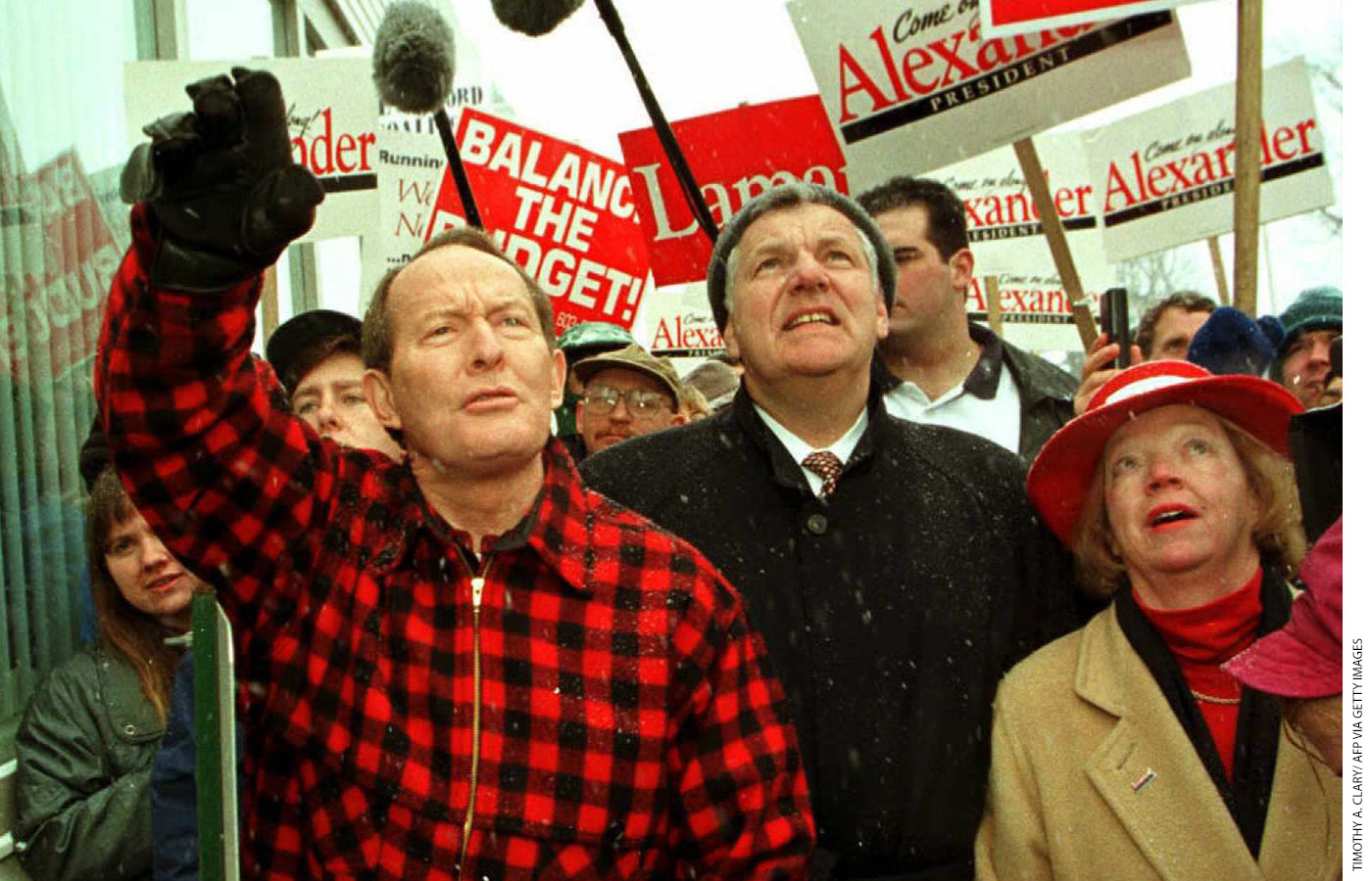 Alexander waves to supporters in Milford, New Hampshire, during his presidential campaign, February 14, 1996.