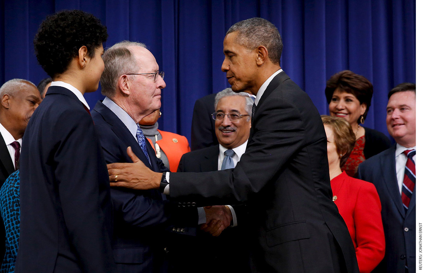President Barack Obama shakes hands with Alexander after signing the Every Student Succeeds Act into law on December 10, 2015.