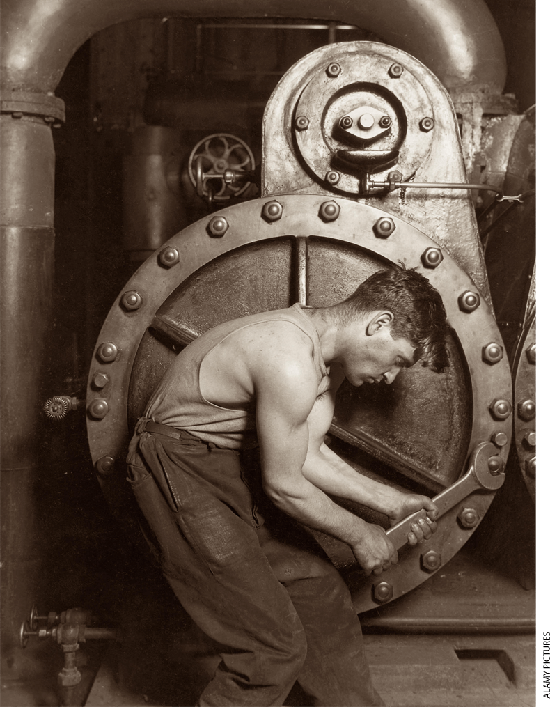 Man working on machinery in a factory