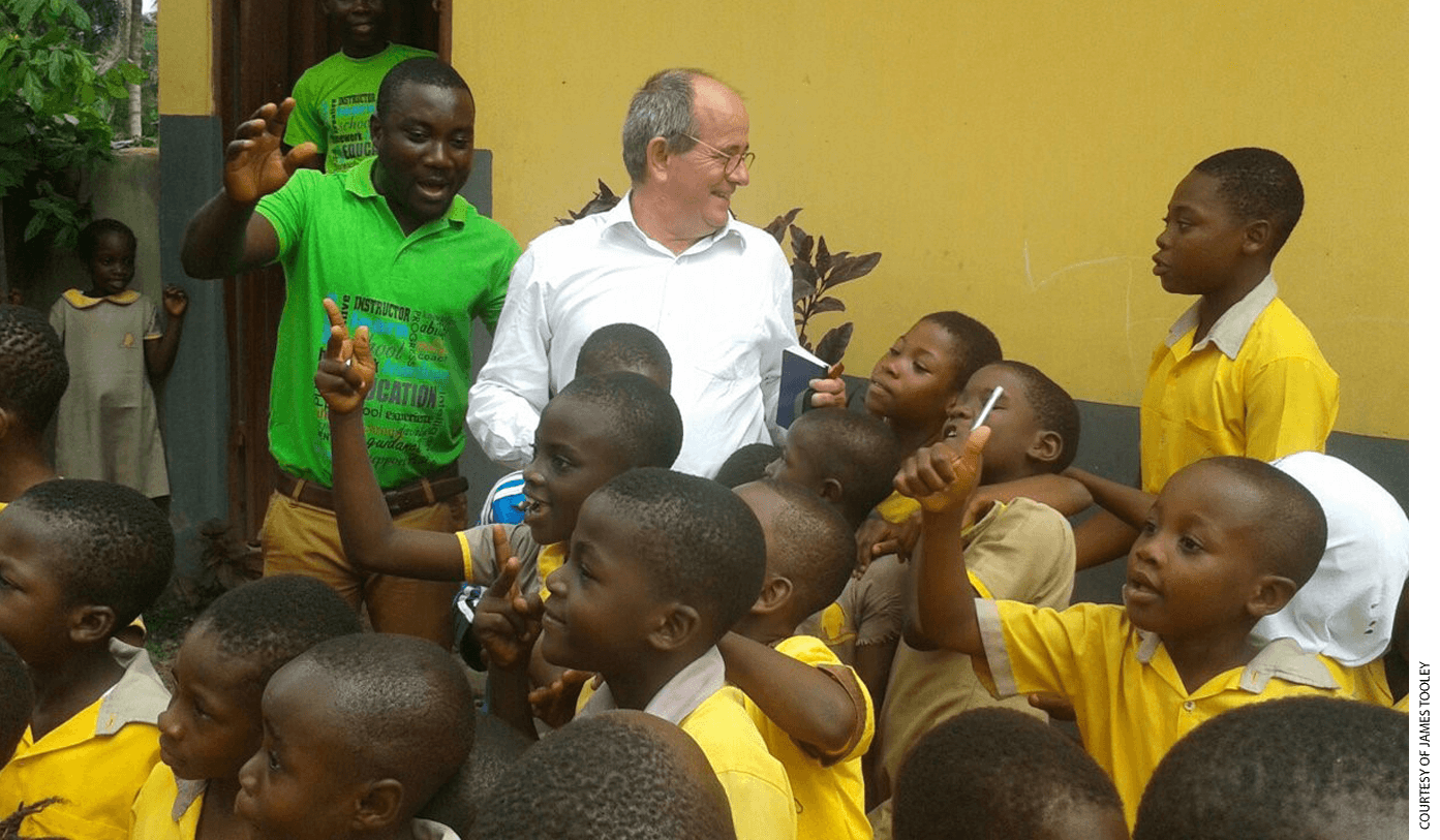 Professor James Tooley with students at an Omega private school in Bawjiase, Ghana.