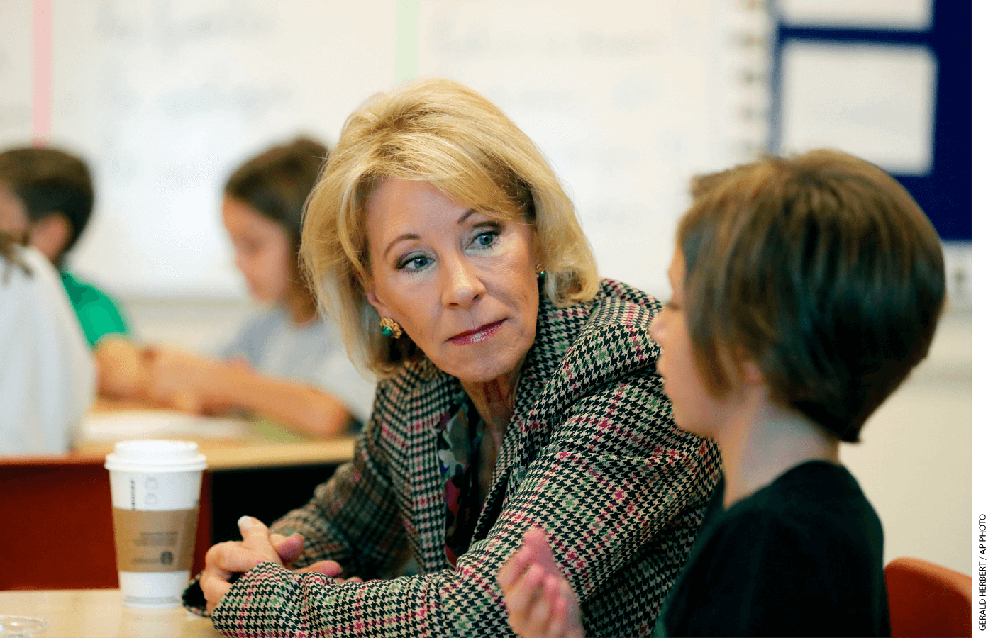 Education Secretary Betsy DeVos visits a classroom at the Edward Hynes Charter School in New Orleans, Friday, Oct. 5, 2018.