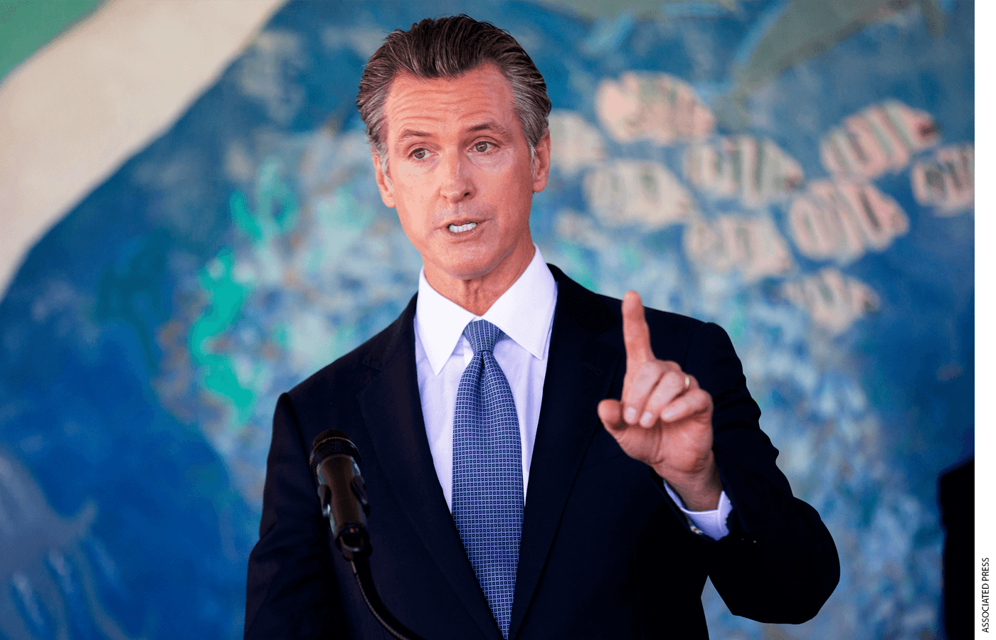 """In this Aug. 11, 2021 file photo, California Gov. Gavin Newsom speaks during a news conference at the Carl B. Munck Elementary School in Oakland, Calif. While talking to reporters during an online interview, Friday, Aug. 13, 2021, Republican Larry Elder promised that if Newsom is ousted in the Sept. 14 election, any mask or vaccine mandates in place at the time """"will be suspended right away"""""""